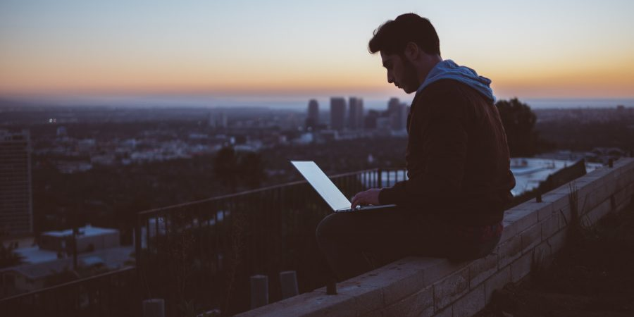 Man sitting alone with laptop remote working